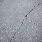 close-up-cracked-asphalt-road-background