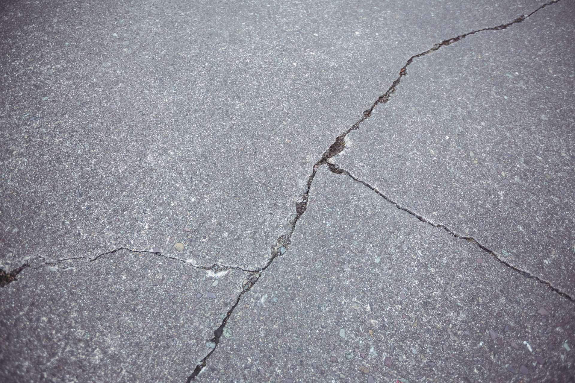 close-up-cracked-asphalt-road-background